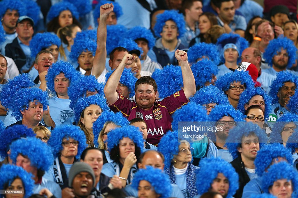 Maroons supporter in the crowd celebrates as they are awarded a try during game three of the ARL State of Origin series between the New South Wales...
