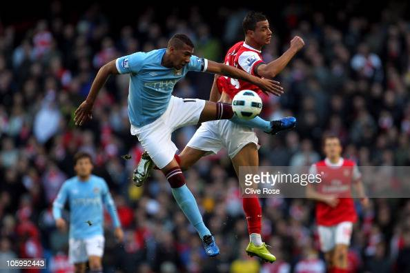 Marouane Chamakh of Arsenal is challenged by Jerome Boatang of Manchester City during the Barclays Premier League match between Manchester City and...