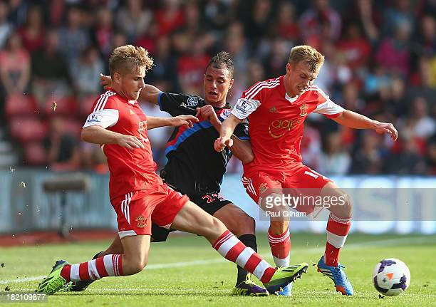 Marouane Chamakh of Crystal Palace battles for the ball with Luke Shaw and James WardProwse of Southampton during the Barclays Premier League match...