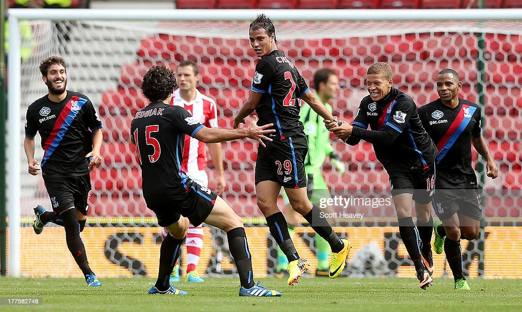 Marouane Chamakh of Crystal Palace celebrates after scoring their first goal during the Barclays Premier League match between Stoke City and Crystal Palace at Britannia Stadium on August 24, 2013 in Stoke on Trent, England.