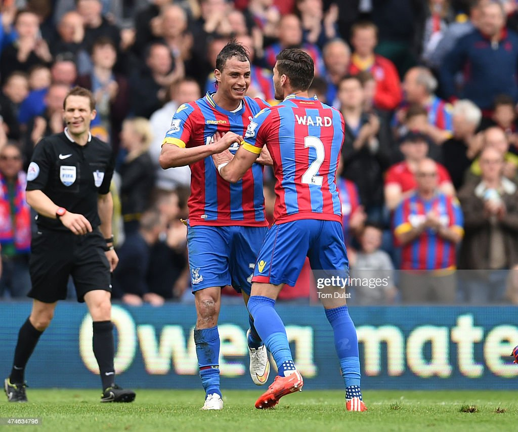 Marouane Chamakh of Crystal Palace celebrates scoring his team's first goal with his team mate Joel Ward during the Barclays Premier League match between Crystal Palace and Swansea City at Selhurst Park on May 24, 2015 in London, England.