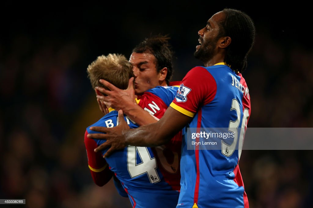 <a gi-track='captionPersonalityLinkClicked' href=/galleries/search?phrase=Marouane+Chamakh&family=editorial&specificpeople=727555 ng-click='$event.stopPropagation()'>Marouane Chamakh</a> (C) of Crystal Palace celebrates with teammates <a gi-track='captionPersonalityLinkClicked' href=/galleries/search?phrase=Barry+Bannan&family=editorial&specificpeople=5449430 ng-click='$event.stopPropagation()'>Barry Bannan</a> (L) and <a gi-track='captionPersonalityLinkClicked' href=/galleries/search?phrase=Cameron+Jerome&family=editorial&specificpeople=815275 ng-click='$event.stopPropagation()'>Cameron Jerome</a> (R) after scoring the opening goal during the Barclays Premier League match between Crystal Palace and West Ham United at Selhurst Park on December 3, 2013 in London, England.