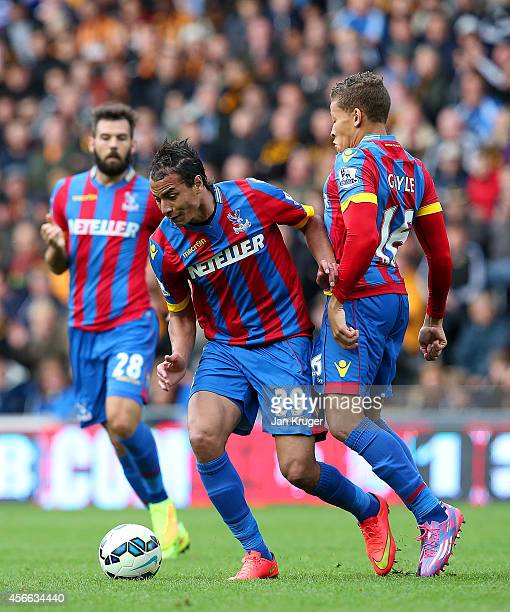 Marouane Chamakh of Crystal Palace runs with the ball past teammate Dwight Gayle of Crystal Palace during the Barclays Premier League match between...