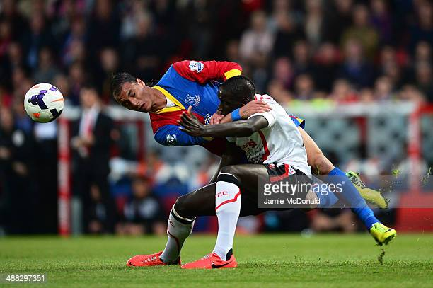 Marouane Chamakh of Crystal Palace wins a header under pressure from Mamadou Sakho of Liverpool during the Barclays Premier League match between...
