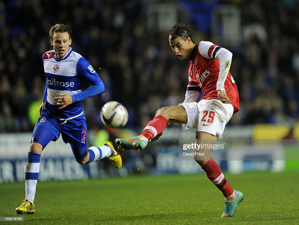 Marouane Chamakh scores Arsenal's seventh goal as Chris Gunter of Reading closes in during the Capital One Cup match between Arsenal and Reading at Madejski Stadium on October 30, 2012 in Reading, England.