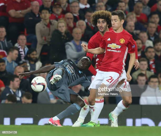 Marouane Fellaini and Ander Herrera of Manchester United in action with Pione Sisto of Celta Vigo during the UEFA Europa League semi final second leg...