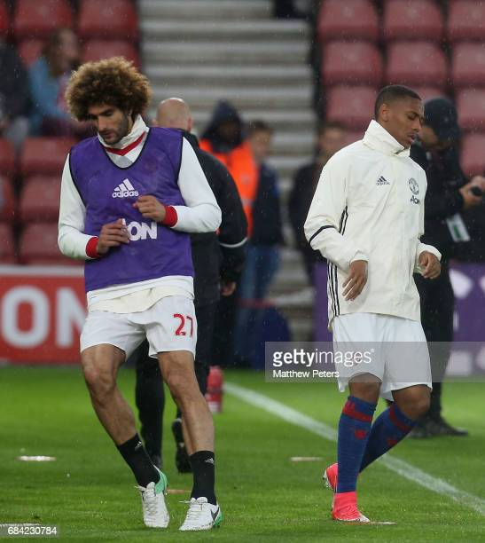 Marouane Fellaini and Anthony Martial of Manchester United warm up ahead of the Premier League match between Southampton and Manchester United at St...