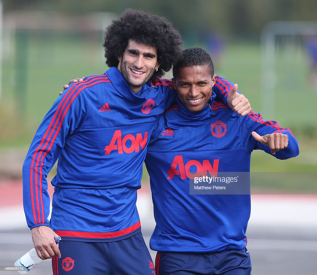 Marouane Fellaini (L) and Antonio Valencia of Manchester United in action during a first team training session at Aon Training Complex on September 25, 2015 in Manchester, England.