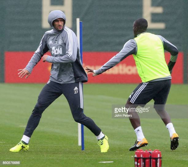 Marouane Fellaini and Eric Bailly of Manchester United in action during a first team training session at Aon Training Complex on September 21 2017 in...