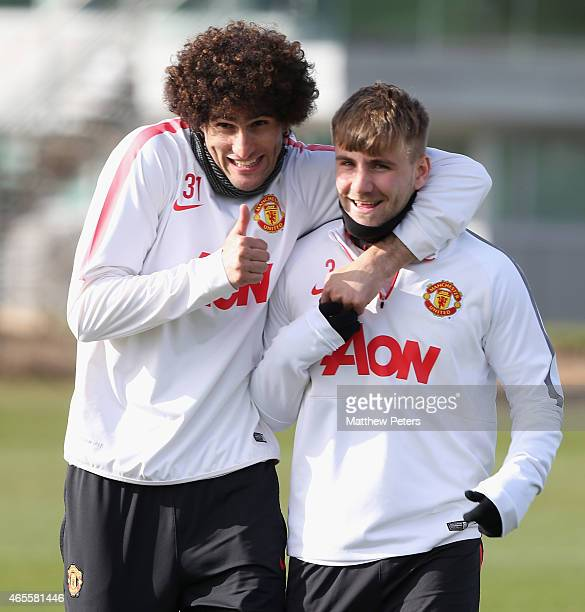 Marouane Fellaini and Luke Shaw of Manchester United in action during a first team training session at Aon Training Complex on March 8 2015 in...