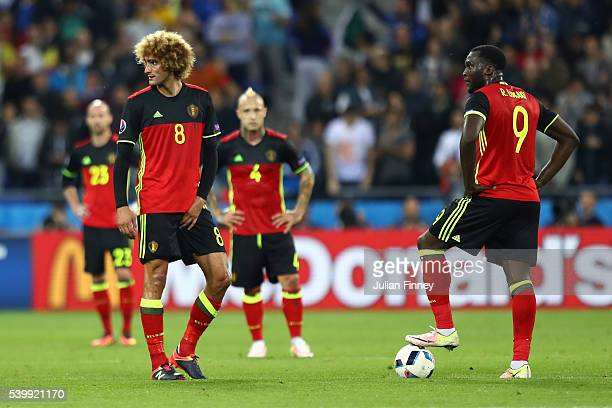 Marouane Fellaini and Romelu Lukaku of Belgium react after Italy's first goal during the UEFA EURO 2016 Group E match between Belgium and Italy at...