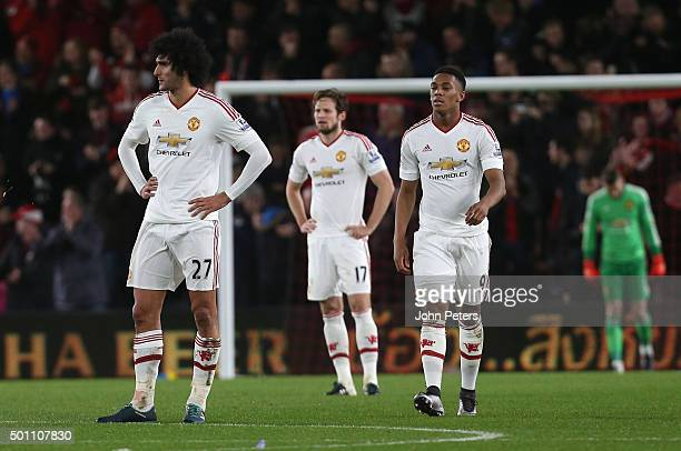 Marouane Fellaini Daley Blind and Anthony Martial of Manchester United show their disappointment at Joshua King of AFC Bournemouth scoring their...