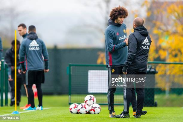 Marouane Fellaini midfielder of Belgium and Roberto Martinez head coach of Belgian Team during a training session of the National Soccer Team of...