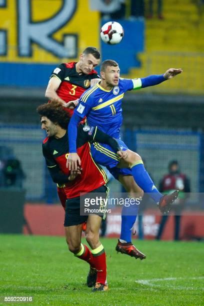 Marouane Fellaini midfielder of Belgium and Thomas Vermaelen defender of Belgium and Edin Dzeko forward of Bosnia Herzegovina during the World Cup...