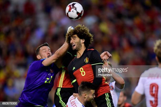 Marouane Fellaini midfielder of Belgium jumps towards the ball in front of Jiri Pavlenka goalkeeper of Czech Republic during a FIFA international...