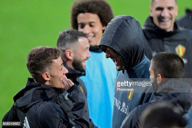 Marouane Fellaini midfielder of Belgium laughing with Thorgan Hazard midfielder of Belgium during a training session of the National Soccer Team of...