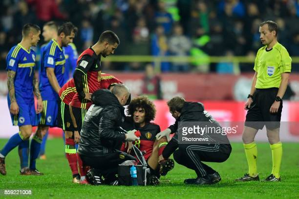 Marouane Fellaini midfielder of Belgium leaves the field with an injury during the World Cup Qualifier Group H match between Bosnia and Herzegovina...