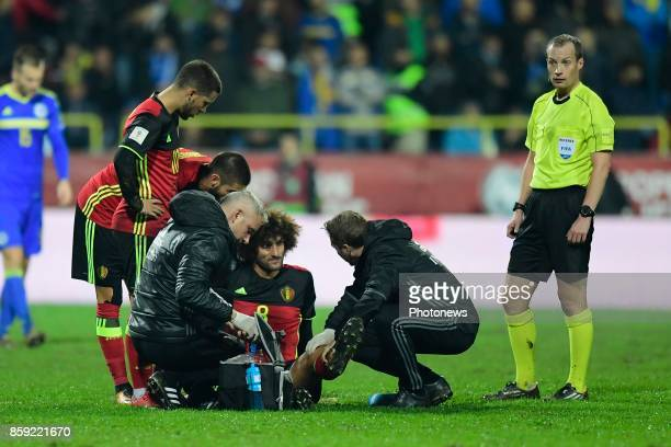 Marouane Fellaini midfielder of Belgium receives medical attention for his injury during the World Cup Qualifier Group H match between Bosnia and...