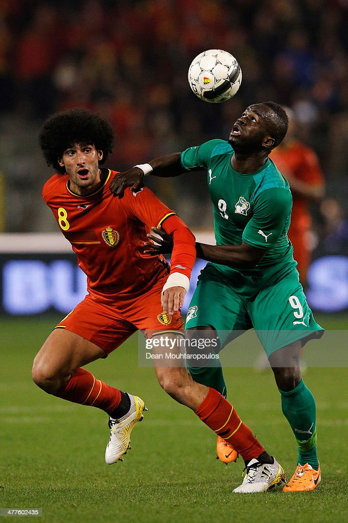 <a gi-track='captionPersonalityLinkClicked' href=/galleries/search?phrase=Marouane+Fellaini&family=editorial&specificpeople=3936316 ng-click='$event.stopPropagation()'>Marouane Fellaini</a> of Belgium and Ismael Cheik Tiote of Ivory Coast battle for the ball during the International Friendly match between Belgium and Ivory Coast at The King Baudouin Stadium on March 5, 2014 in Brussels, Belgium.