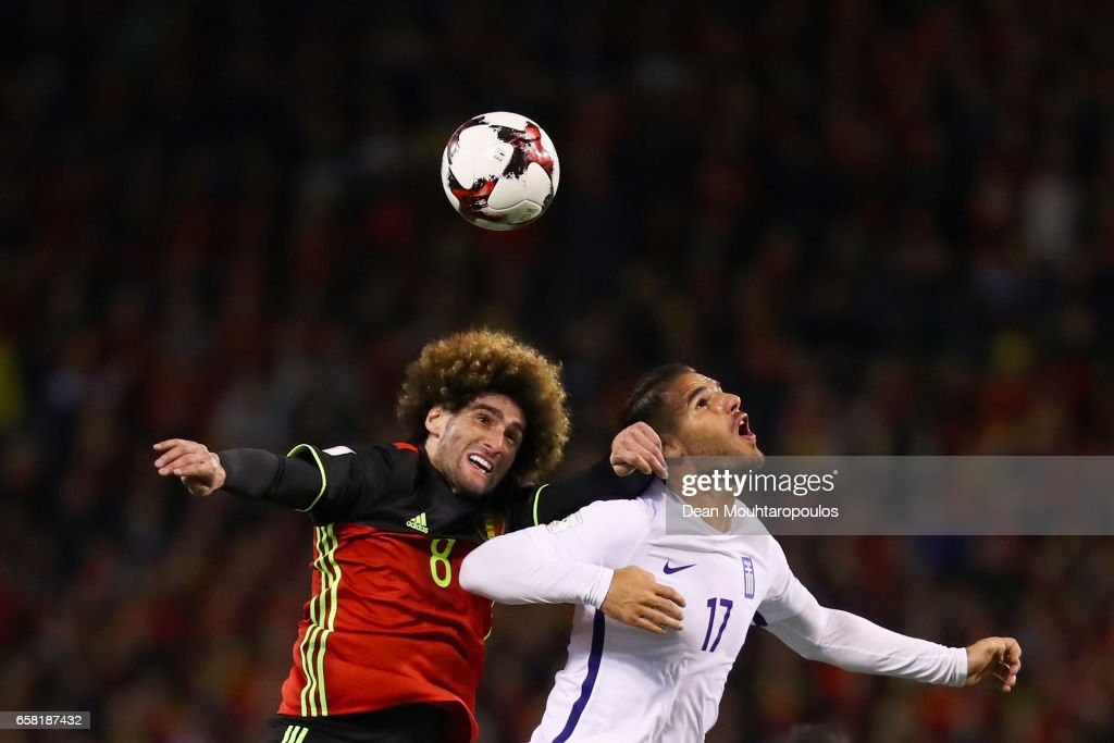 Marouane Fellaini of Belgium battles for the ball with Panagiotis Tachtsidis of Greece during the FIFA 2018 World Cup Group H Qualifier match between Belgium and Greece at Stade Roi Baudouis on March 25, 2017 in Brussels, Belgium.