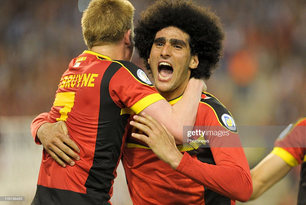 Marouane Fellaini of Belgium celebrates a goal during the FIFA 2014 World Cup Group A qualifying match between Belgium and Serbia at the King Baudouin stadium on June 07, 2013 in Brussels, Belgium.