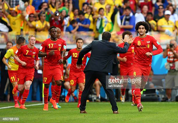 Marouane Fellaini of Belgium celebrates scoring his team's first goal with head coach Marc Wilmots during the 2014 FIFA World Cup Brazil Group H...