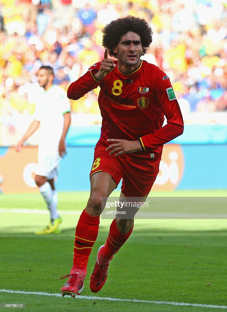 <a gi-track='captionPersonalityLinkClicked' href=/galleries/search?phrase=Marouane+Fellaini&family=editorial&specificpeople=3936316 ng-click='$event.stopPropagation()'>Marouane Fellaini</a> of Belgium celebrates scoring his team's first goal during the 2014 FIFA World Cup Brazil Group H match between Belgium and Algeria at Estadio Mineirao on June 17, 2014 in Belo Horizonte, Brazil.