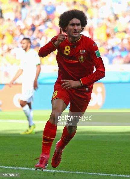 Marouane Fellaini of Belgium celebrates scoring his team's first goal during the 2014 FIFA World Cup Brazil Group H match between Belgium and Algeria...