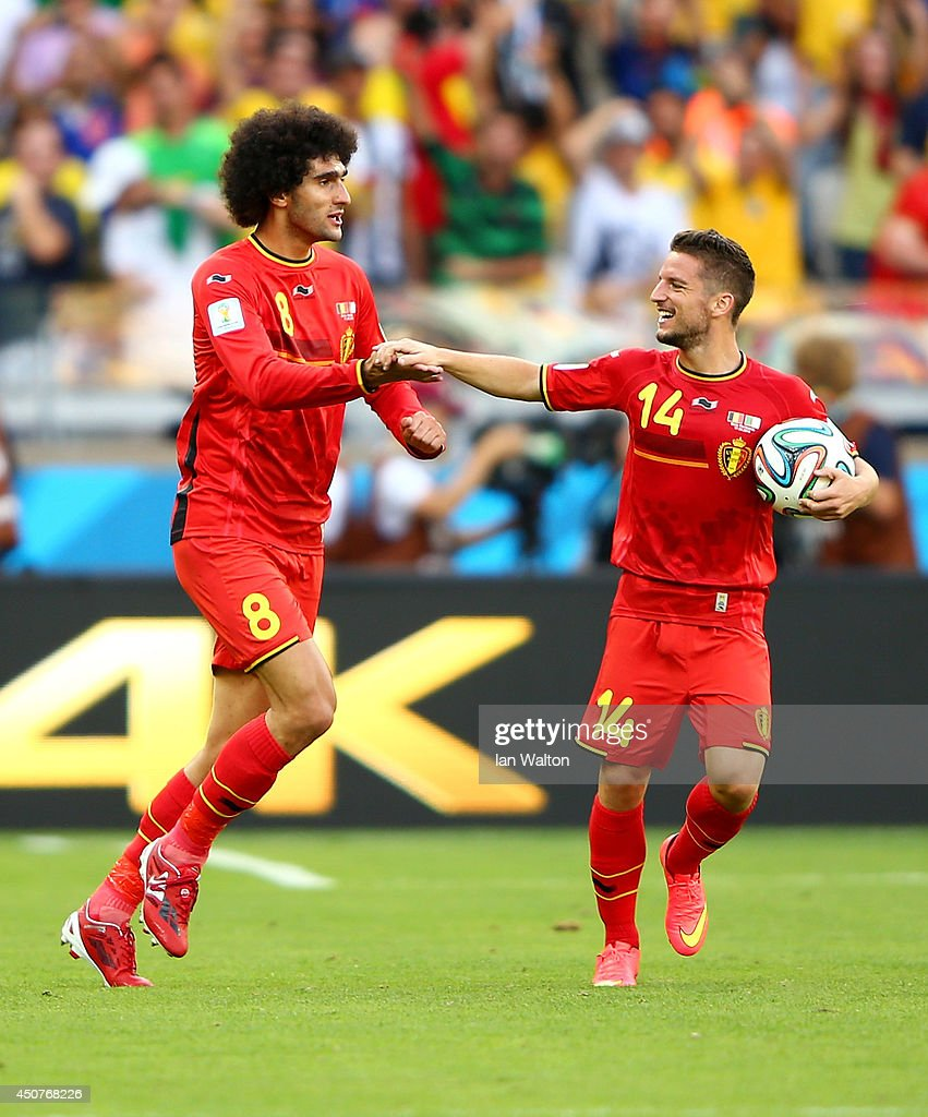 <a gi-track='captionPersonalityLinkClicked' href=/galleries/search?phrase=Marouane+Fellaini&family=editorial&specificpeople=3936316 ng-click='$event.stopPropagation()'>Marouane Fellaini</a> of Belgium (L) celebrates scoring his team's first goal with <a gi-track='captionPersonalityLinkClicked' href=/galleries/search?phrase=Dries+Mertens&family=editorial&specificpeople=6524919 ng-click='$event.stopPropagation()'>Dries Mertens</a> during the 2014 FIFA World Cup Brazil Group H match between Belgium and Algeria at Estadio Mineirao on June 17, 2014 in Belo Horizonte, Brazil.