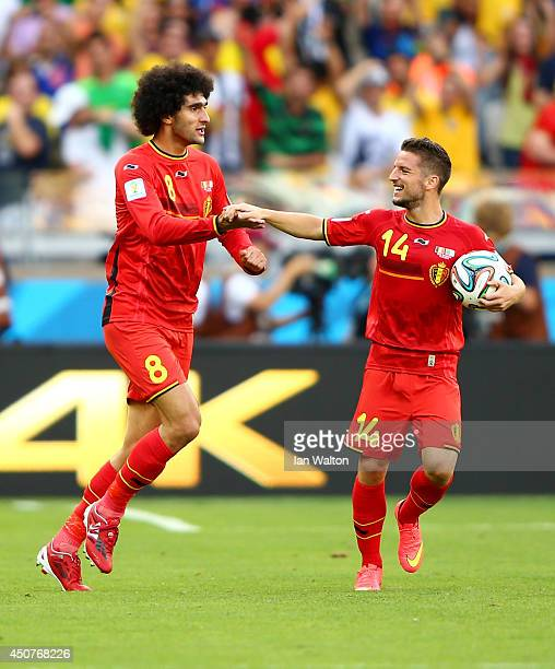 Marouane Fellaini of Belgium celebrates scoring his team's first goal with Dries Mertens during the 2014 FIFA World Cup Brazil Group H match between...