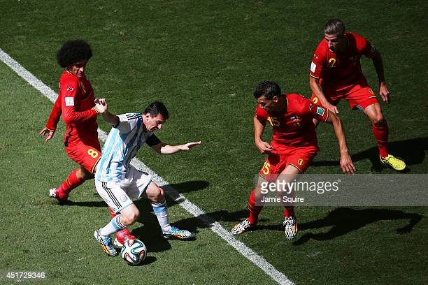 Marouane Fellaini of Belgium challenges Lionel Messi of Argentina during the 2014 FIFA World Cup Brazil Quarter Final match between Argentina and...