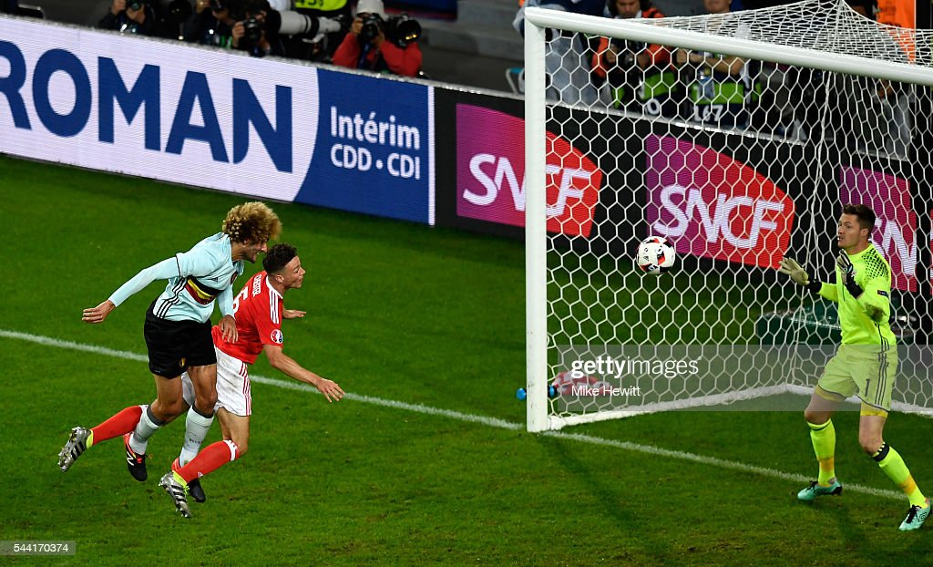 Marouane Fellaini of Belgium heads the ball wide during the UEFA EURO 2016 quarter final match between Wales and Belgium at Stade Pierre-Mauroy on July 1, 2016 in Lille, France.