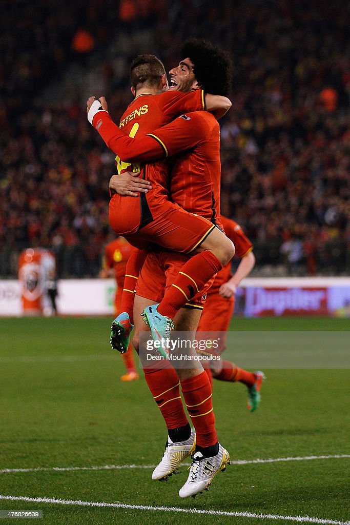 <a gi-track='captionPersonalityLinkClicked' href=/galleries/search?phrase=Marouane+Fellaini&family=editorial&specificpeople=3936316 ng-click='$event.stopPropagation()'>Marouane Fellaini</a> #8 of Belgium is congratulated by team mate <a gi-track='captionPersonalityLinkClicked' href=/galleries/search?phrase=Dries+Mertens&family=editorial&specificpeople=6524919 ng-click='$event.stopPropagation()'>Dries Mertens</a> after he scores the first goal of the game during the International Friendly match between Belgium and Ivory Coast at The King Baudouin Stadium on March 5, 2014 in Brussels, Belgium.