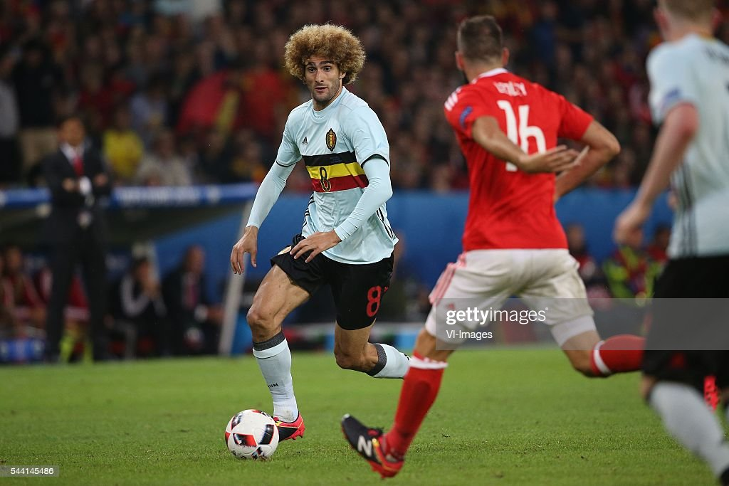 Marouane Fellaini of Belgium, Joe Ledley of Wales during the UEFA EURO 2016 quarter final match between Wales and Belgium on July 2, 2016 at the Stade Pierre Mauroy in Lille, France.