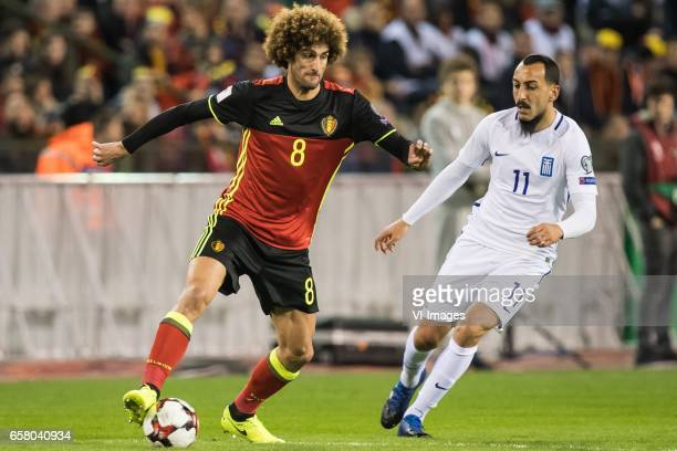 Marouane Fellaini of Belgium Konstantinos Mitroglou of Greeceduring the FIFA World Cup 2018 qualifying match between Belgium and Bosnie Herzegowina...