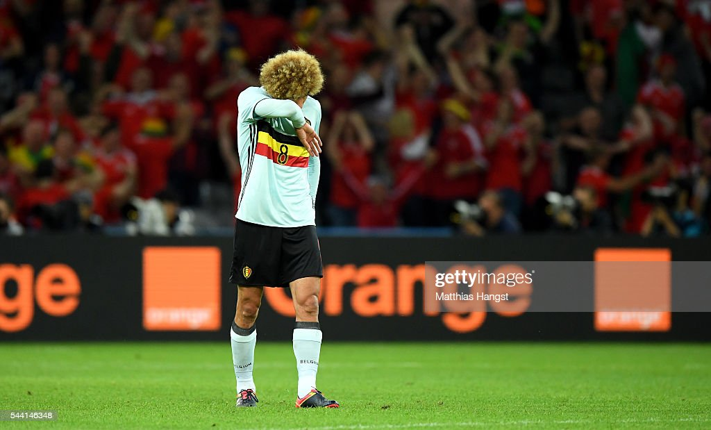 Marouane Fellaini of Belgium reacts after Wales' second goal during the UEFA EURO 2016 quarter final match between Wales and Belgium at Stade Pierre-Mauroy on July 1, 2016 in Lille, France.