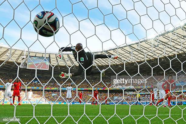 Marouane Fellaini of Belgium scores his team's first goal on a header past Rais M'Bolhi of Algeria during the 2014 FIFA World Cup Brazil Group H...