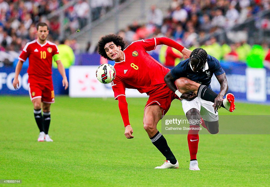 Marouane Fellaini #8 of Belgium tries to control the ball against Bacary Sagna #15 of France during the international friendly game between France and Belgium at Stade de France on June 7, 2015 in Saint Denis near Paris, France.