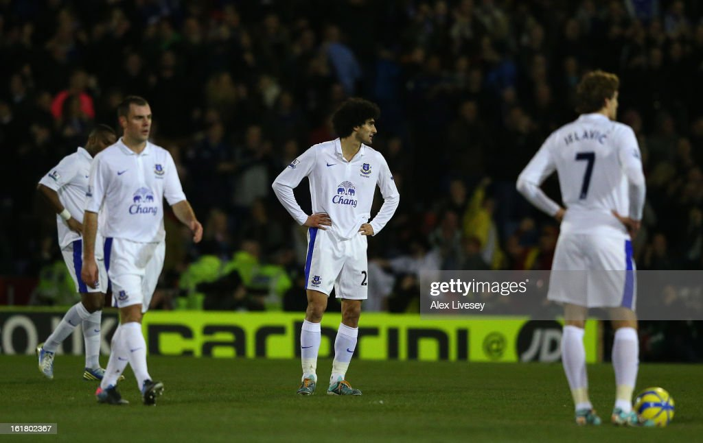 Marouane Fellaini of Everton and his team-mates react after conceding the first goal during the FA Cup with Budweiser Fifth Round match between Oldham Athletic and Everton at Boundary Park on February 16, 2013 in Oldham, England.