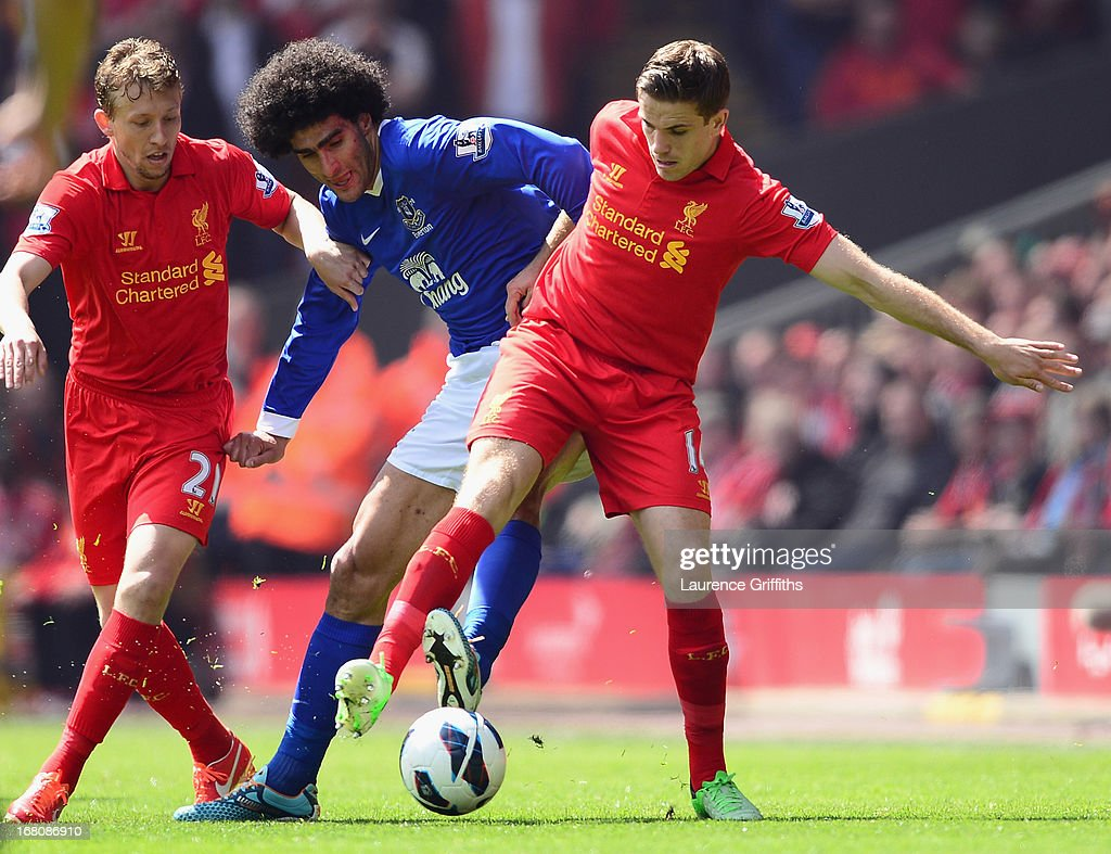 Marouane Fellaini of Everton battles for the ball with Jordan Henderson of Liverpool during the Barclays Premier League match between Liverpool and Everton at Anfield on May 5, 2013 in Liverpool, England.