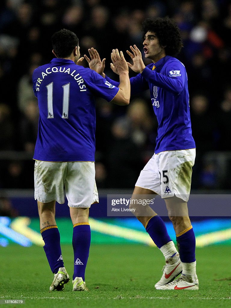 <a gi-track='captionPersonalityLinkClicked' href=/galleries/search?phrase=Marouane+Fellaini&family=editorial&specificpeople=3936316 ng-click='$event.stopPropagation()'>Marouane Fellaini</a> of Everton celebrates scoring his team's second goal with team mate Denis Stracqualursi (L) during the FA Cup Fourth Round match between Everton and Fulham at Goodison Park on January 27, 2012 in Liverpool, England.
