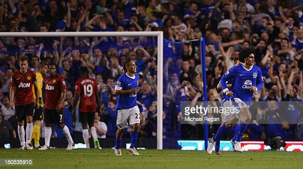 Marouane Fellaini of Everton celebrates scoring the opening goal during the Barclays Premier League match between Everton and Manchester United at...