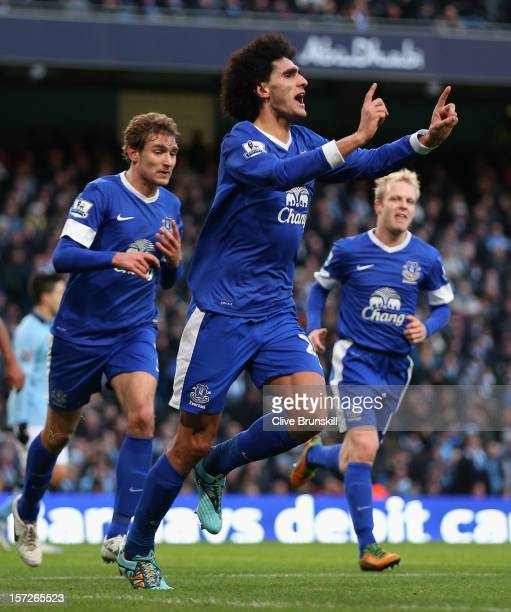 Marouane Fellaini of Everton celebrates scoring the opening goal during the Barclays Premier League match between Manchester City and Everton at the...