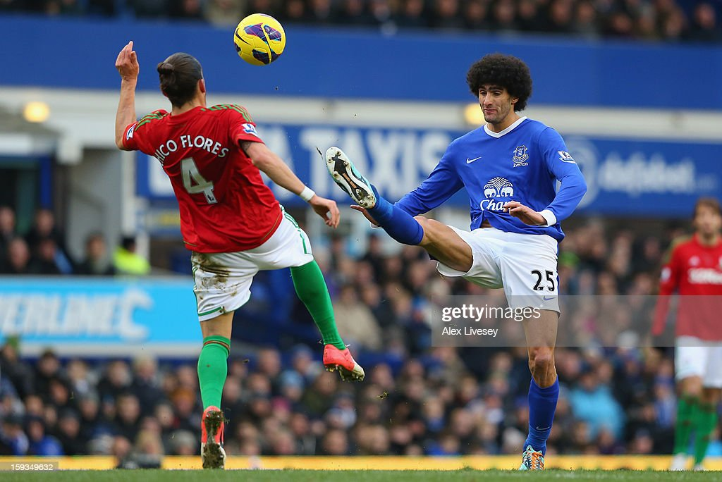 <a gi-track='captionPersonalityLinkClicked' href=/galleries/search?phrase=Marouane+Fellaini&family=editorial&specificpeople=3936316 ng-click='$event.stopPropagation()'>Marouane Fellaini</a> of Everton challenges Chico Flores of Swansea City during the Barclays Premier League match between Everton and Swansea City at Goodison Park on January 12, 2013 in Liverpool, England.