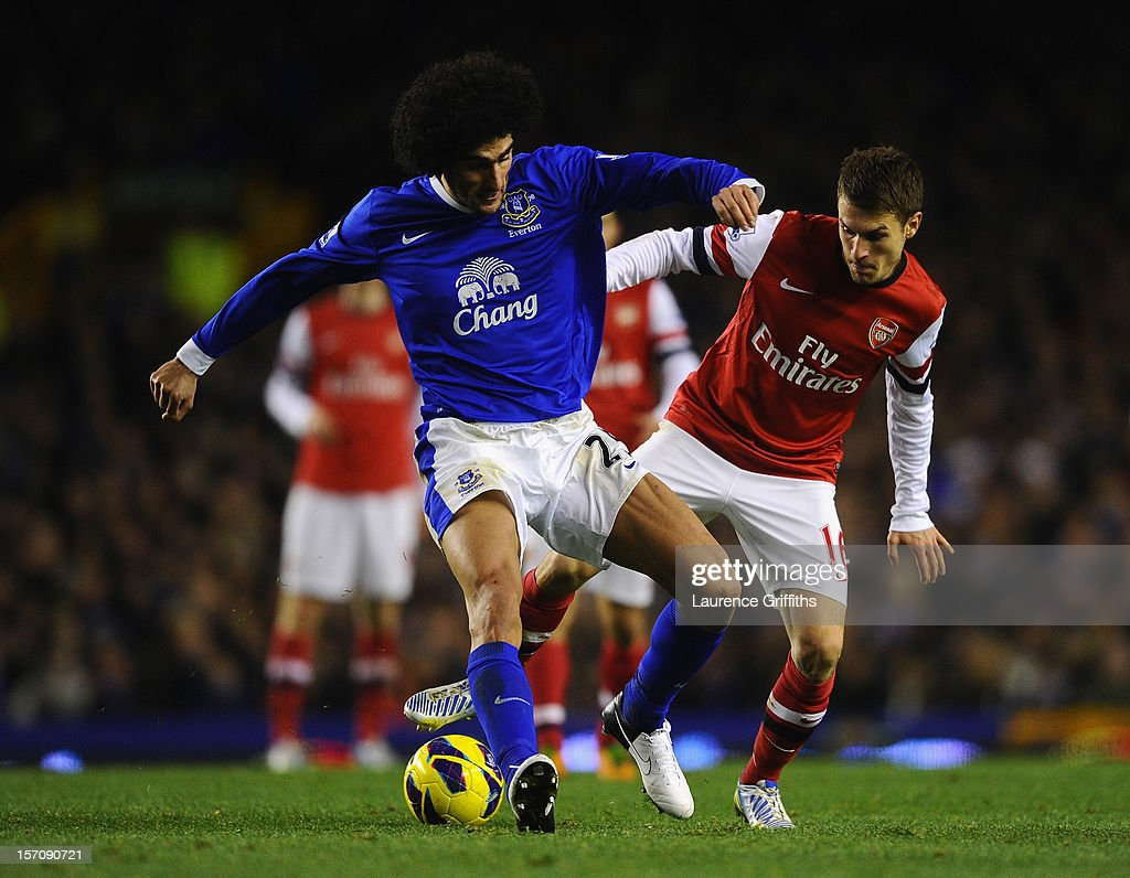 <a gi-track='captionPersonalityLinkClicked' href=/galleries/search?phrase=Marouane+Fellaini&family=editorial&specificpeople=3936316 ng-click='$event.stopPropagation()'>Marouane Fellaini</a> of Everton competes with <a gi-track='captionPersonalityLinkClicked' href=/galleries/search?phrase=Aaron+Ramsey+-+Soccer+Player&family=editorial&specificpeople=4784114 ng-click='$event.stopPropagation()'>Aaron Ramsey</a> of Arsenal during the Barclays Premier League match between Everton and Arsenal at Goodison Park on November 28, 2012 in Liverpool, England.