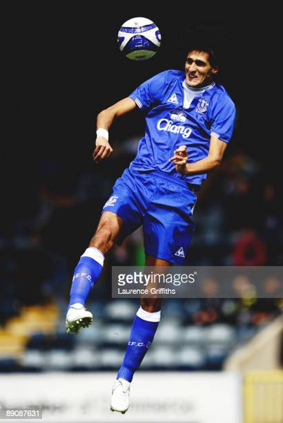 Marouane Fellaini of Everton heads the ball during the Pre Season Friendly match between Rochdale and Everton at the Spotland Stadium on July 18 2009...