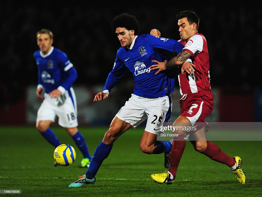 Marouane Fellaini of Everton holds off Marlon Pack of Cheltenham Town during the FA Cup with Budweiser Third Round match between Cheltenham Town and Everton at Abbey Business Stadium on January 7, 2013 in Cheltenham, England.