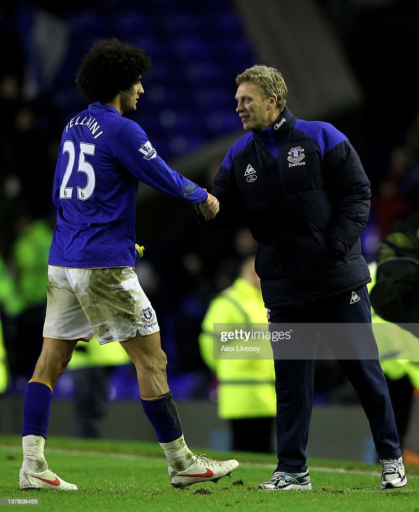 <a gi-track='captionPersonalityLinkClicked' href=/galleries/search?phrase=Marouane+Fellaini&family=editorial&specificpeople=3936316 ng-click='$event.stopPropagation()'>Marouane Fellaini</a> of Everton is congratulated by his Manager <a gi-track='captionPersonalityLinkClicked' href=/galleries/search?phrase=David+Moyes&family=editorial&specificpeople=215482 ng-click='$event.stopPropagation()'>David Moyes</a> at the end of the FA Cup Fourth Round match between Everton and Fulham at Goodison Park on January 27, 2012 in Liverpool, England.