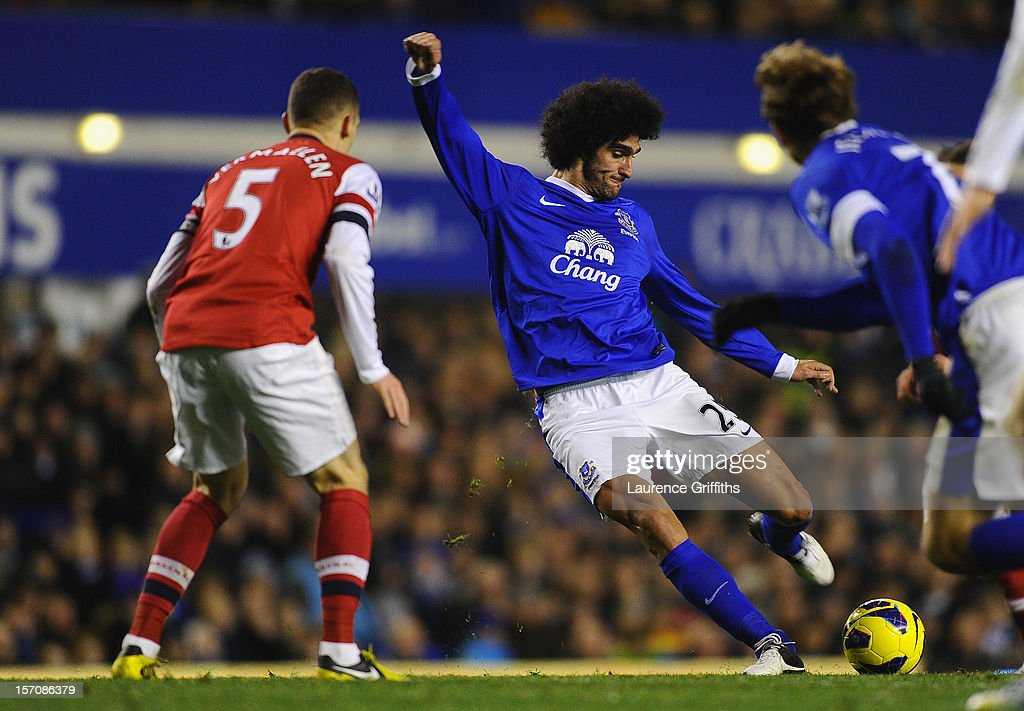 <a gi-track='captionPersonalityLinkClicked' href=/galleries/search?phrase=Marouane+Fellaini&family=editorial&specificpeople=3936316 ng-click='$event.stopPropagation()'>Marouane Fellaini</a> of Everton scores his team's first goal to make the score 1-1 during the Barclays Premier League match between Everton and Arsenal at Goodison Park on November 28, 2012 in Liverpool, England.
