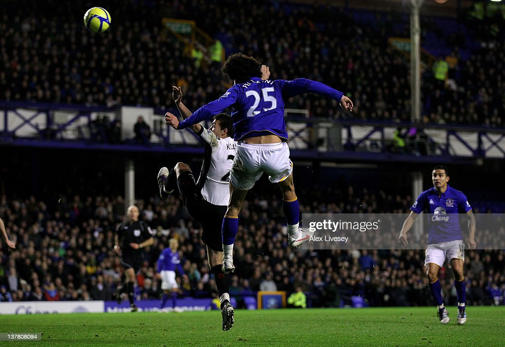 <a gi-track='captionPersonalityLinkClicked' href=/galleries/search?phrase=Marouane+Fellaini&family=editorial&specificpeople=3936316 ng-click='$event.stopPropagation()'>Marouane Fellaini</a> of Everton scores his team's second goal during the FA Cup Fourth Round match between Everton and Fulham at Goodison Park on January 27, 2012 in Liverpool, England.